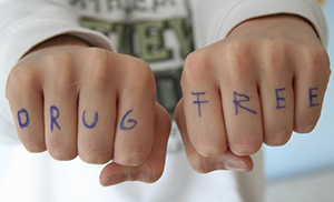 'drug free' written on knuckles