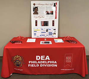 Red Ribbon Table Outside DEA Office