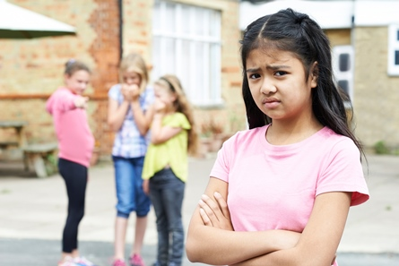 image of girl being gossiped about by her classmates
