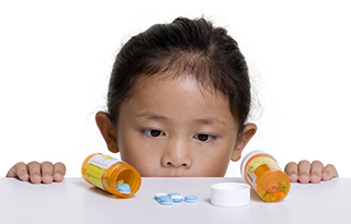 Child with Prescription Medicine bottles