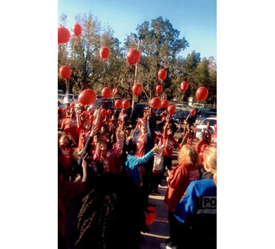red ribbon balloon release