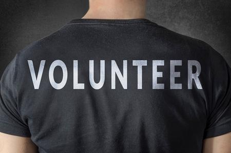 man wearing a shirt that says 'volunteer'