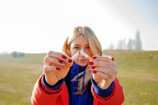 teen girl with broken cigarette